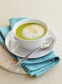 Cream of vegetable soup with milk foam in cup