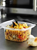 Paella in plastic packaging to take away