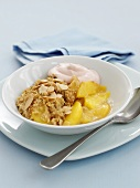 Peach crumble with flaked almonds in dish