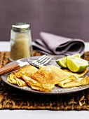 Pancakes with sugar and lime wedges