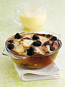 Blackberry and apple pudding with custard