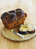 Cinnamon raisin bread, one slice buttered with honey
