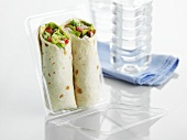 Wraps in plastic packaging to take away
