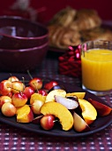 Christmas breakfast with fruit salad and orange juice
