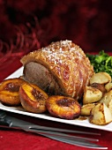 Traditional roast pork with peaches for Christmas