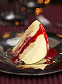 Lemon layered dessert with red berry sauce
