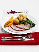 Roast ham with potatoes, carrots and green beans