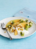 Melon and kiwi fruit salad with almond yoghurt