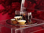 Mulled wine and mince pies on a silver plate