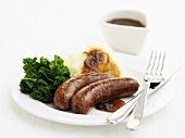 Beef sausages with broccoli and mashed potato