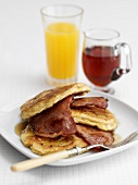 Pancakes with bacon and maple syrup, orange juice