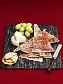 Chips, crackers, soft cheese and grapes