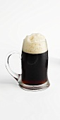 Dark beer in a glass tankard