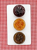 Three different jams in glass dishes (from above)