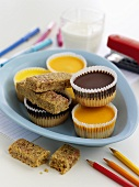 Sweet cup cakes and muesli bars for children