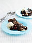 Chocolate pancakes with banana, cherries and vanilla ice-cream