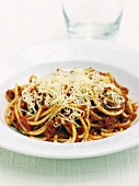 Spaghetti Bolognese with grated cheese