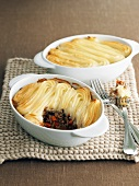 Two shepherds pies in casserole dishes (England)