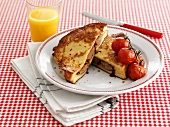 French toast with sausage and cherry tomatoes, orange juice
