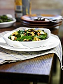 Spinach with apples and pine nuts (Spain)