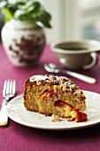 A slice of plum and hazelnut cake