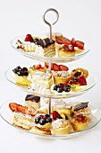 3 tier cake stand with different types of petit fours