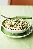 Spelt spaghetti with green asparagus, peas and mint
