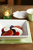 Mozzarella with red berries and blood oranges