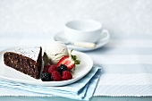 Piece of chocolate & hazelnut cake with vanilla ice cream & berries