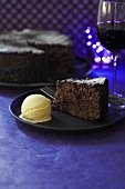 Chocolate cake with vanilla ice cream and dessert wine