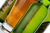 Different types of beer in bottles and glass
