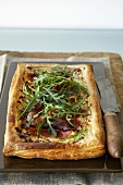Parma ham and ricotta puff pastry tart with rocket