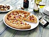 Piri piri pizza, mobile phone and wine
