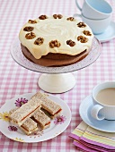 Walnut cake and salmon and cucumber sandwiches with tea