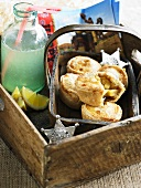 Mini apple pies and lemonade in a wooden box