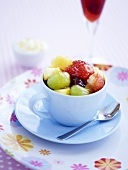 Fruit salad with honey in a cup