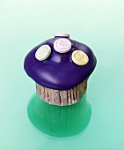 Muffin with purple icing and fizzy sweets