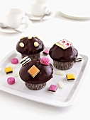 Muffins with chocolate icing and liquorice allsorts