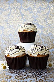 Muffins with cream topping and chocolate decorations