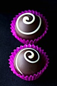 Dark ganache chocolates with white chocolate spirals