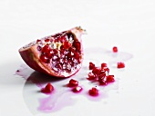 Wedge of pomegranate and pomegranate seeds