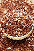 Red rice in and beside a dish