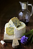 Blue Stilton cheese on a wooden board