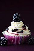 Cupcake with buttercream and blackberries