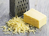 Cheddar cheese, a piece and grated