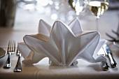Folded fabric napkin on elegant table