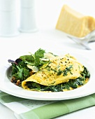 Rocket omelette with salad leaves and Parmesan