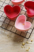 Red and pink, heart-shaped silicone baking moulds