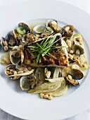 Fried cod on fennel, beans and shellfish