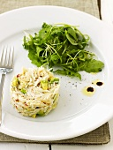 Crabmeat and avocado salad with salad leaves